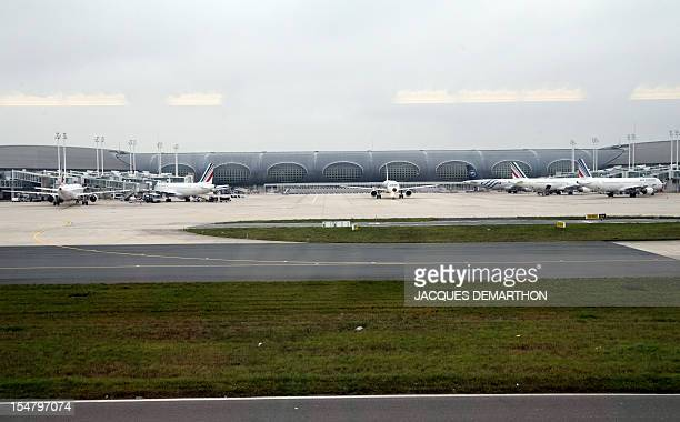 A photo taken on October 26 2012 shows Air France aircraft parked at the Terminal 2 of the RoissyCharlesdeGaulle airport in RoissyenFrance northern...