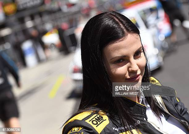A photo taken on October 5 2016 shows Australian racing driver Renee Gracie smiling during media interviews as she and codriver Swiss driving ace...