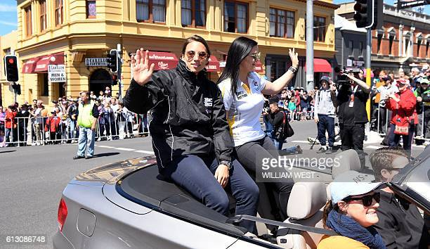 A photo taken on October 5 2016 shows Swiss driving ace Simona de Silvestro and codriver Australian Renee Gracie waving to fans during a driver's...