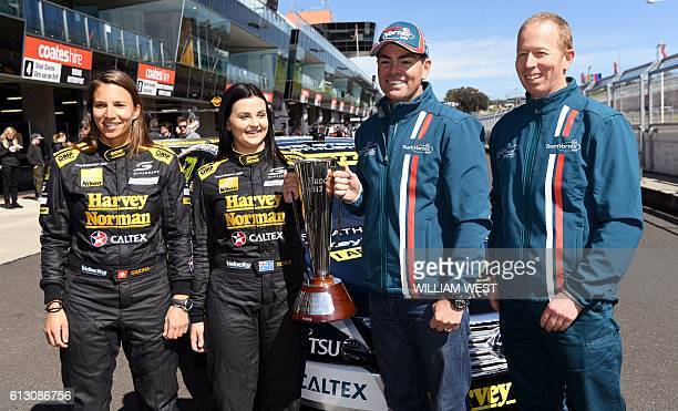 A photo taken on October 5 2016 shows Swiss driving ace Simona de Silvestro and codriver Australian Renee Gracie holding the trophy with fellow...
