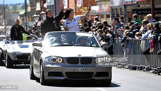 A photo taken on October 5 2016 shows Swiss driving ace Simona de Silvestro and codriver Australian Renee Gracie waving to the fans during a driver's...