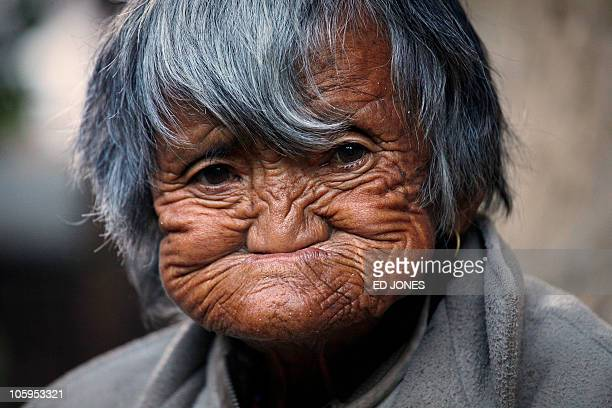 Photo taken on October 6 2010 shows an elderly Bhutanese woman outside her home in a village near the town of Haa The Haa valley lies along the...