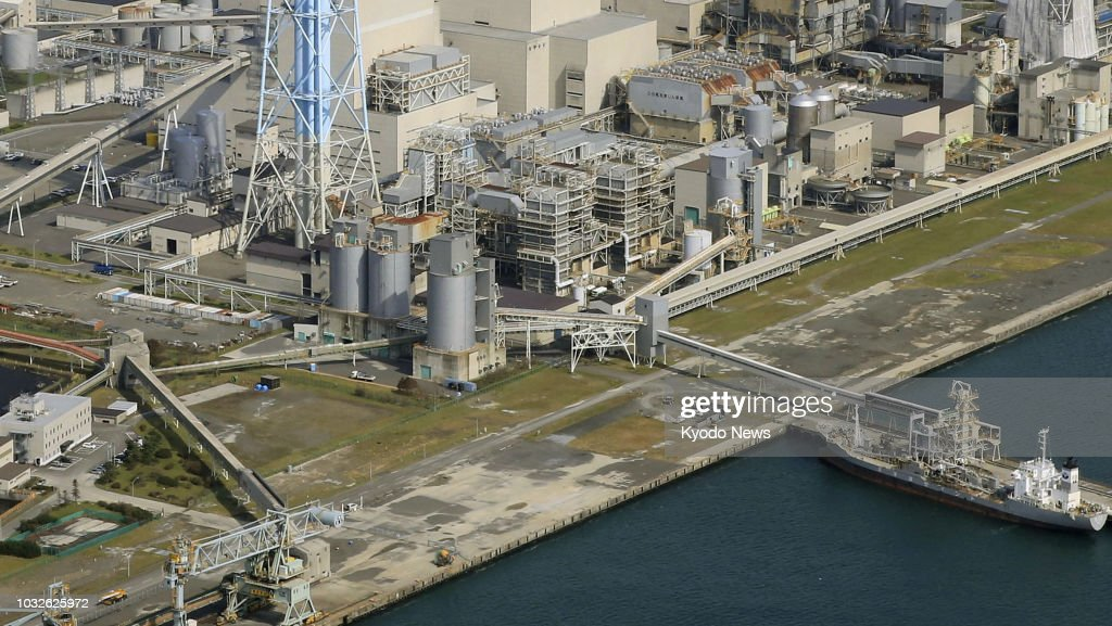 Photo taken on Sept. 12, 2018, from a Kyodo News airplane shows the Tomatoatsuma power plant (top) where soil liquefaction is confirmed to have occurred during a powerful earthquake that hit Japan's northernmost main island on Sept. 6. ==Kyodo