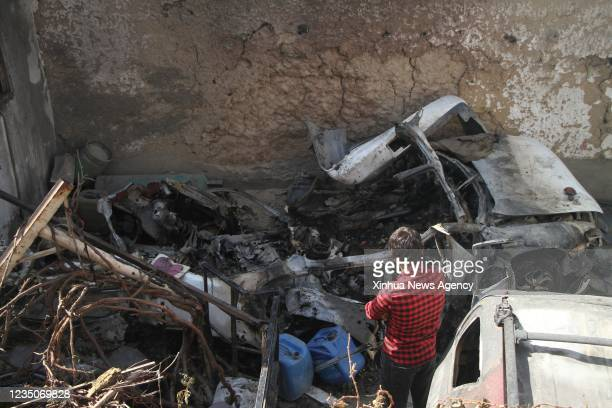 """Photo taken on Sept. 2, 2021 shows damaged vehicles at the site of the U.S. Airstrike in Kabul, capital of Afghanistan. TO GO WITH: """"Feature:..."""