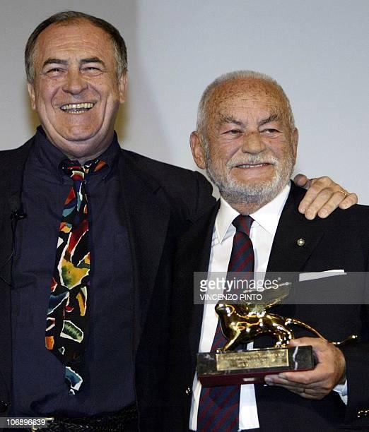 Photo taken on September 1 2003 of Italian producer Dino De Laurentiis shows the Golden Lion received from director Bernardo Bertolucci for his...