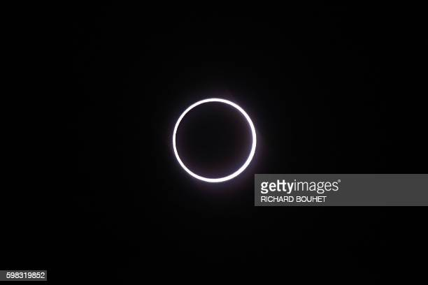 TOPSHOT Photo taken on September 1 in SaintLouis on the Indian Ocean island of La Reunion shows the moon covering the sun leaving a ring of fire...