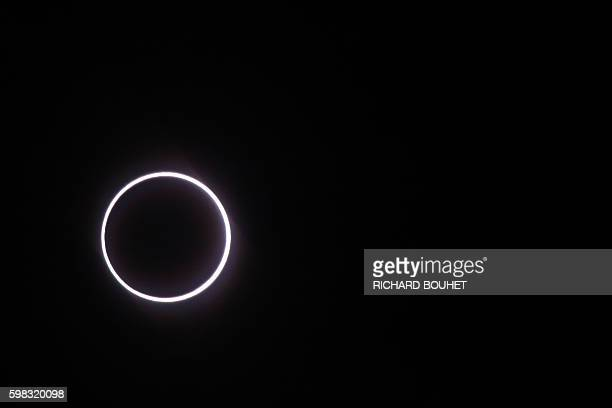 Photo taken on September 1 in Saint-Louis, on the Indian Ocean island of La Reunion, shows the moon covering the sun, leaving a ring of fire effect...