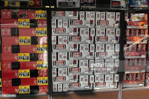 A photo taken on September 10 2013 shows cartons of cigarettes on display in the shopwindow of a tobacco vendor in AndorralaViella in the...