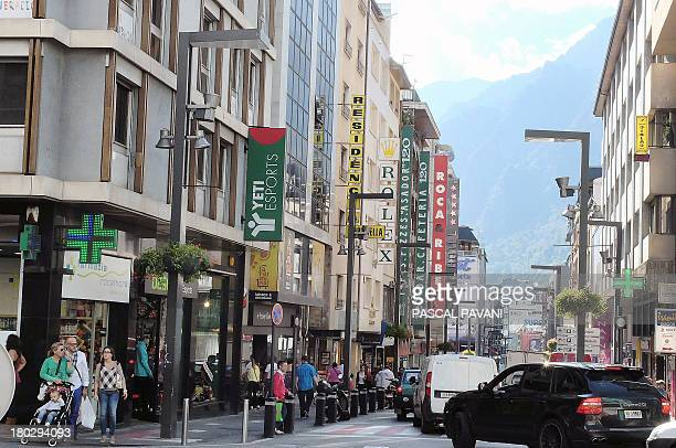 A photo taken on September 10 2013 shows people walking on a street of AndorralaViella in the principality of Andorra AFP PHOTO PASCAL PAVANI