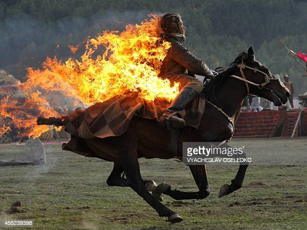 Photo taken on September 10 2014 shows a Kyrgyz stuntman performing during the first World Nomad Games in the Kyrchin gorge some 300 km from Bishkek...