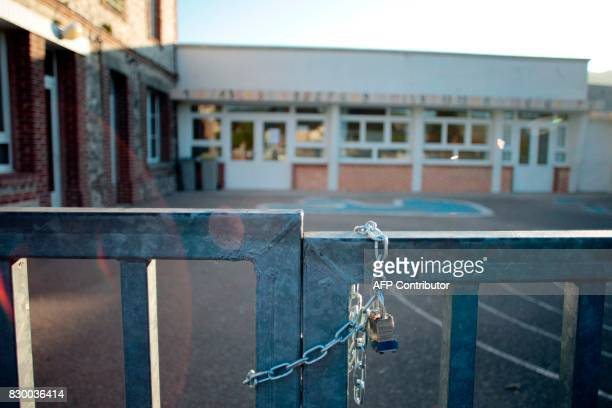 A photo taken on September 10 2014 shows the closed gate at the Ganzeville school in Normandy after the mayor decided to close it on Wednesday...