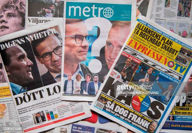 A photo taken on September 10 2018 in Stockholm shows a selection of front pages of Swedish newspapers in Stockholm a day after the general elections...