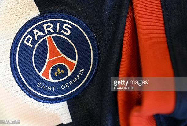 A photo taken on September 11 2014 in Paris shows a partial view of the new jersey of the Paris Saint Germain football team AFP PHOTO / FRANCK FIFE