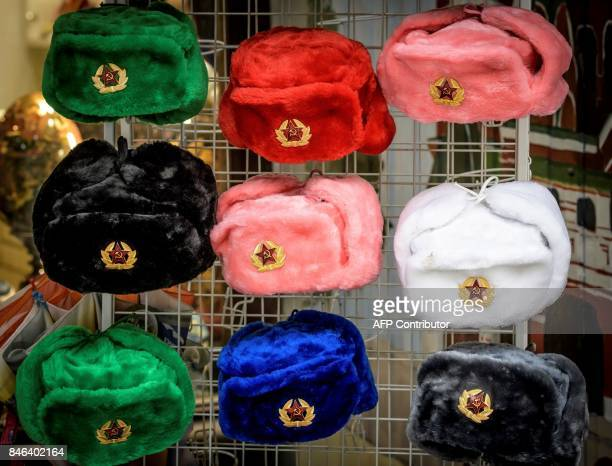 A photo taken on September 13 2017 shows traditional Russian fur 'Ushanka' hats displayed outside a souvenir shop in downtown Moscow / AFP PHOTO /...