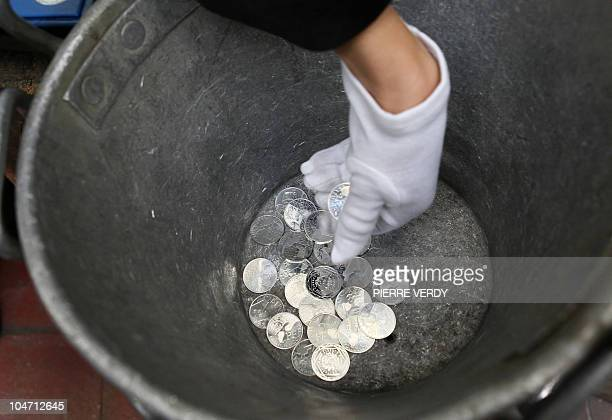 Photo taken on September 16 2010 at the Monnaie de Paris shows some 10euro coins from a new limited collection of coins bearing the names of the 22...
