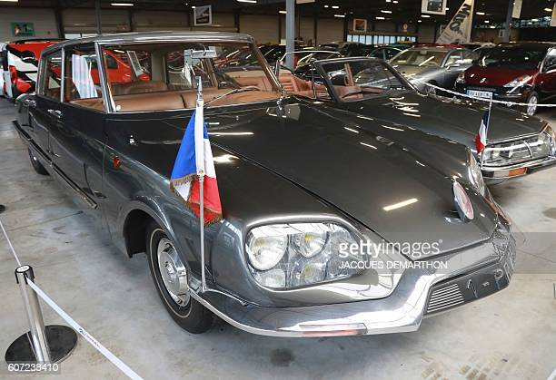 A photo taken on September 17 2016 shows a presidential 1968 Citroen DS 21 at the Conservatoire Citroen museum in AulnaysousBois The museum houses a...