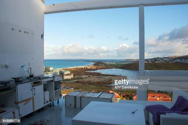 A photo taken on September 17 2017 shows a room without a roof or windows at the Alizea residence in Mont Vernon on the French Caribbean island of...
