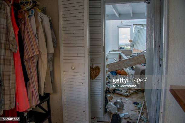 A photo taken on September 17 2017 shows debris inside a home at the Alizea residence in Mont Vernon on the French Caribbean island of Saint Martin...