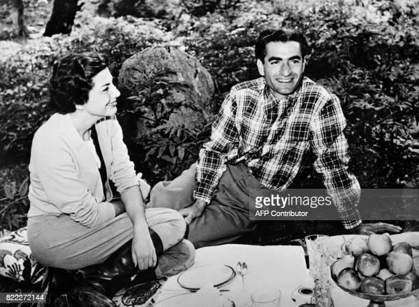 Photo taken on September 18, 1951 shows Mohammad Reza Shah and his wife, Princess Soraya of Iran picnicking in Kelardasht, Northern Iran. / AFP PHOTO...