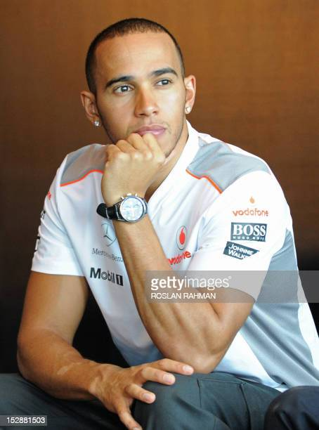 A photo taken on September 19 2012 shows McLarenMercedes driver Lewis Hamilton of Britain attending a promotional event ahead of Formula One's...