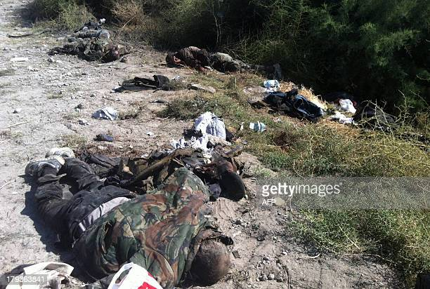 A photo taken on September 2 2013 reportedly shows the bodies of rebel fighters lying on the ground following an army ambush in Adra 36 kilometres...