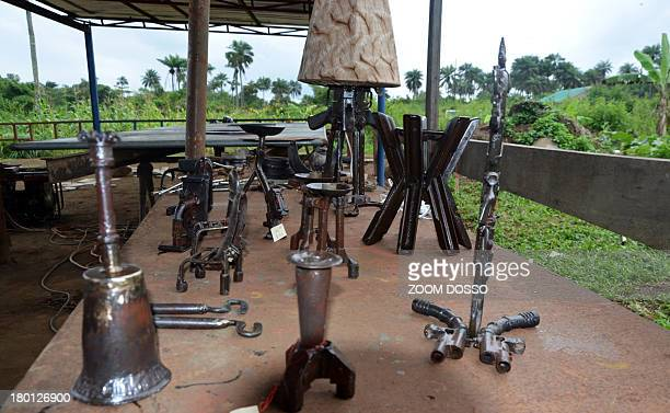 Photo taken on September 2 2013 shows items made from AK47s bazookas and various weaponry in a workshop on the outskirts of the Liberian capital...