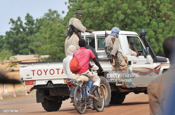 A photo taken on September 21 2012 shows a group of armed Islamists making rounds in Gao the biggest city in northern Mali now under the control of...