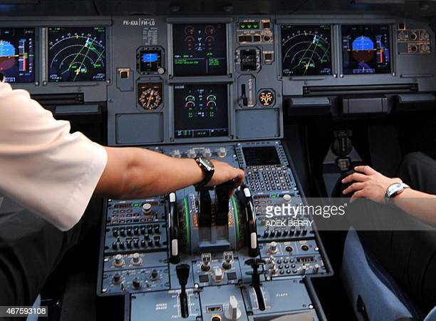 A photo taken on September 24 2008 shows pilots in the cockpit of an Airbus A320 at Cengkareng airport in Jakarta One of the two pilots on the...