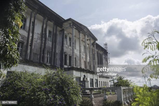 Photo taken on September 27, 2017 shows the Grand Masonic Temple on Benson street in Monrovia, Liberia. / AFP PHOTO / CRISTINA ALDEHUELA