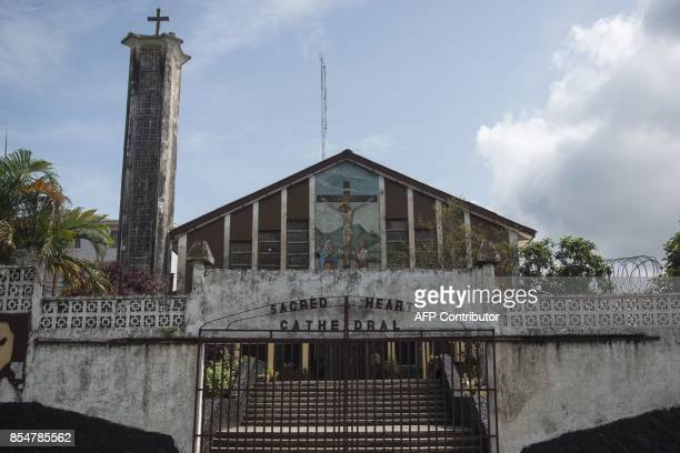 Photo taken on September 27, 2017 shows the Sacred Heart Cathedral in downtown Monrovia, Liberia. / AFP PHOTO / CRISTINA ALDEHUELA