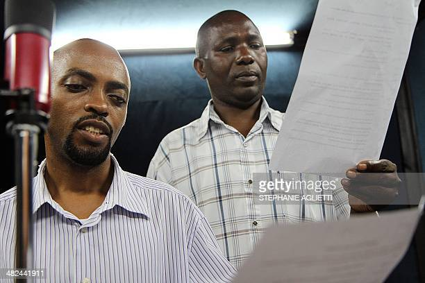 """Photo taken on September 29, 2014 shows actors reading during the recording of an episode of the soap opera """"Musekeweya"""" in Kigali. Twice a week and..."""