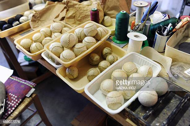 A photo taken on September 3 2014 shows pelotas made with leather and used to play the Basque pelota game at the Ander Ugarte's workshop in Ascain...