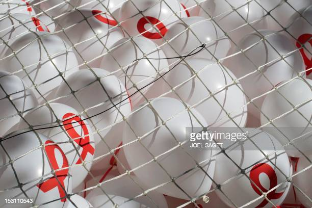 A photo taken on September 30 2012 in Paris shows balloons with the logo of the French NGO Solidarite Sida during the Love Life Parade celebrating...