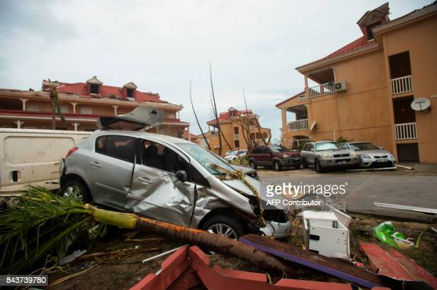 A photo taken on September 6 2017 shows a damaged car and debris in Marigot near the Bay of Nettle on the French Collectivity of Saint Martin after...
