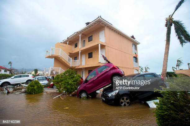 TOPSHOT A photo taken on September 6 2017 shows cars piled on top of one another in Marigot near the Bay of Nettle on the French Collectivity of...