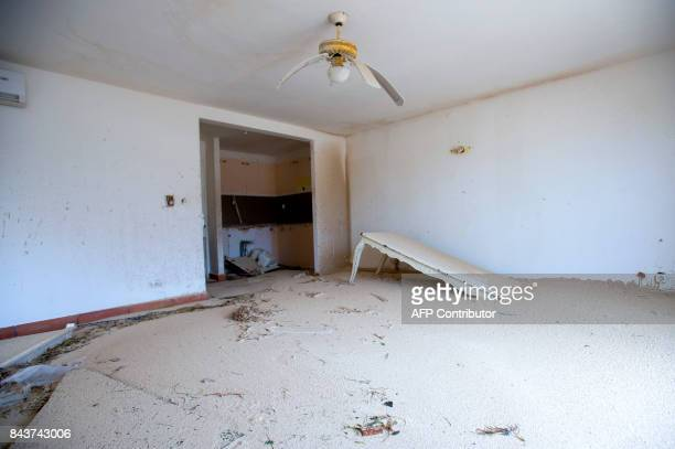 A photo taken on September 6 2017 shows the sandfilled interior of a damaged home in Marigot near the Bay of Nettle on the French Collectivity of...