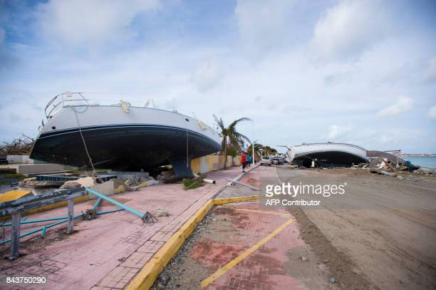 A photo taken on September 7 2017 shows ships wrecked ashore in Marigot near the Bay of Nettle on the island of SaintMartin in the northeast...