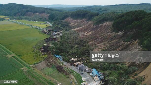 Photo taken on September 7, 2018 shows an aerial view of the massive landslide that destroys several homes and killing at least nine people and...