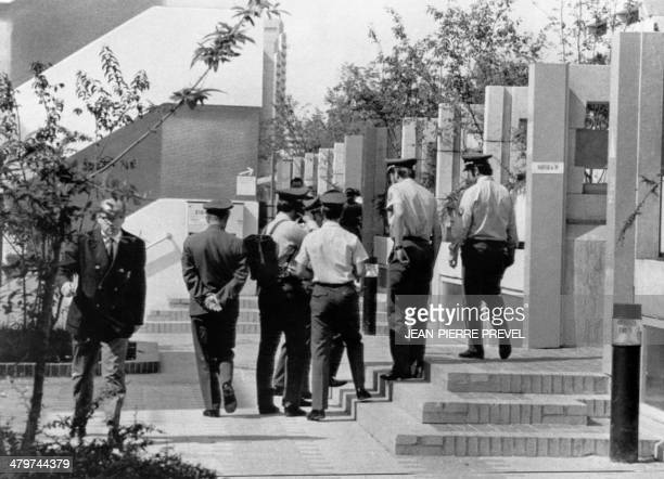 A photo taken on September 8 1972 by former French photographer JeanPierre Prevel shows German police forces patrolling the Olympic village in Munich...