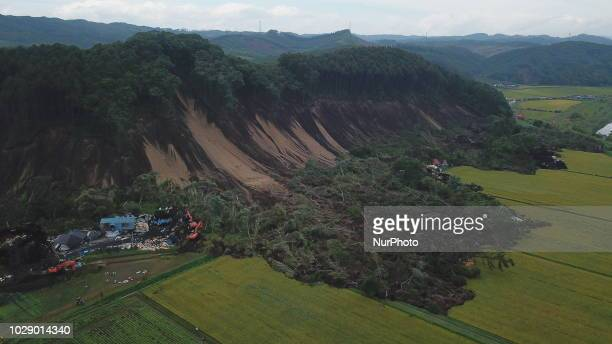 Photo taken on September 8, 2018 shows an aerial view of the massive landslide that destroys several homes and killing several people and leaving...