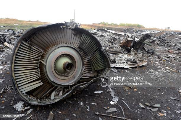 A photo taken on September 9 2014 shows part of the Malaysia Airlines Flight MH17 at the crash site in the village of Hrabove some 80km east of...