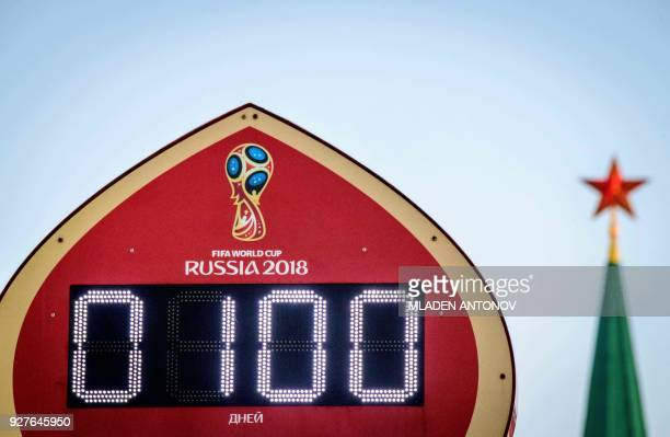 A photo taken on the evening of March 5 2018 shows the digital FIFA World Cup 2018 countdown clock placed in front of the Red Square and the Kremlin...