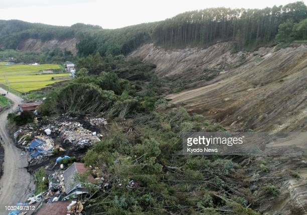 Photo taken Sept 12 from a drone shows houses in Atsuma Hokkaido leveled by a landslide following the Sept 6 earthquake that struck Japan's...