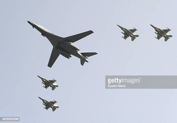 Photo taken Sept 13 shows a B1B Lancer bomber which took off from Guam to fly over the Osan Air Base to the south of Seoul The flight of the two...