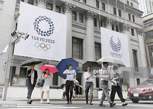 Photo taken Sept 20 shows a commercial facility in Tokyo's Nihonbashi shopping district covered by the logos for the 2020 Tokyo Olympics and...