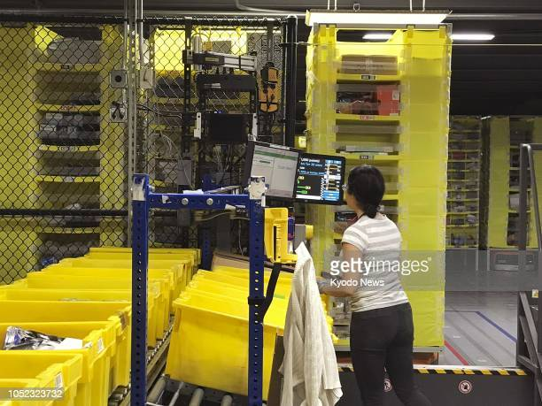 Photo taken Sept 21 shows a distribution center of Amazoncom Inc with automated warehouse robots in the suburbs of Seattle Washington ==Kyodo