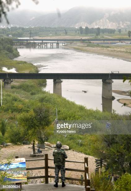 Photo taken Sept 4 shows a Chinese soldier in Tumen a Chinese city in Jilin Province on the North Korean border looking toward North Korea Pyongyang...