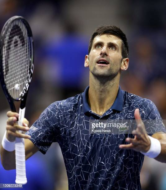 Photo taken Sept 7 shows Novak Djokovic of Serbia celebrating his victory over Kei Nishikori of Japan in the semifinals of the US Open tennis...
