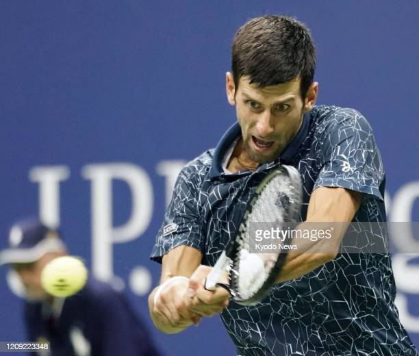 Photo taken Sept 7 shows Novak Djokovic of Serbia playing against Kei Nishikori of Japan in the semifinals of the US Open tennis tournament in New...
