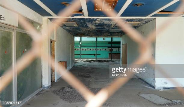 Photo taken through a rusted fence on May 11, 2021 shows the departure hall at the abandoned Nicosia airport in the UN-protected zone of the divided...